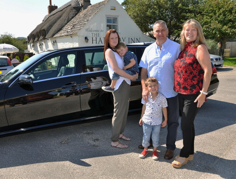 (l-r) Georgie Charman, Riker, Romeo , Phil and Babs Williams outside the Halfway Inn. The family won a chauffeur driven trip to the pub after entering a Dorset Funeral Plan competition at the Margaret Green Animal Rescue open day.