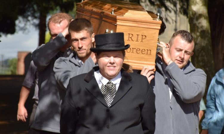 Joanne Hutsby, a partner at Gillotts Funeral Directors in Eastwood, Nottinghamshire, leads a team of pall-bearers from coffin-makers Steve Soult who carried a coffin on the annual Brinsley Coffin Walk
