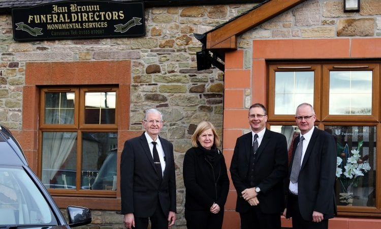 Funeral Partners' operations manager Fraser Mackay welcomes the Brown family, from left, Ian Brown Snr, Elizabeth Brown, Fraser Mackay and Ian Brown Jnr