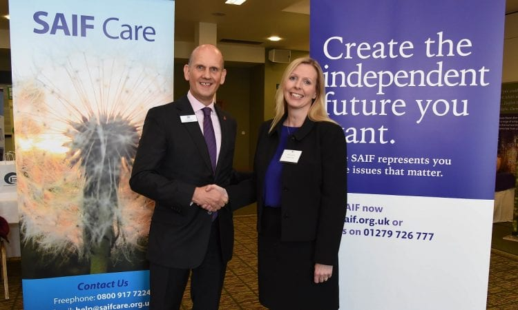 Terry Tennens, CEO of SAIF, and Catherine Betley, of counselling specialist Professional Help, celebrate new partnership between SAIF and the NCS